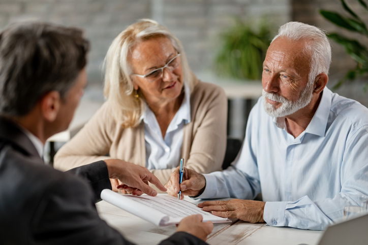 Senior couple meeting with their estate planning attorney office