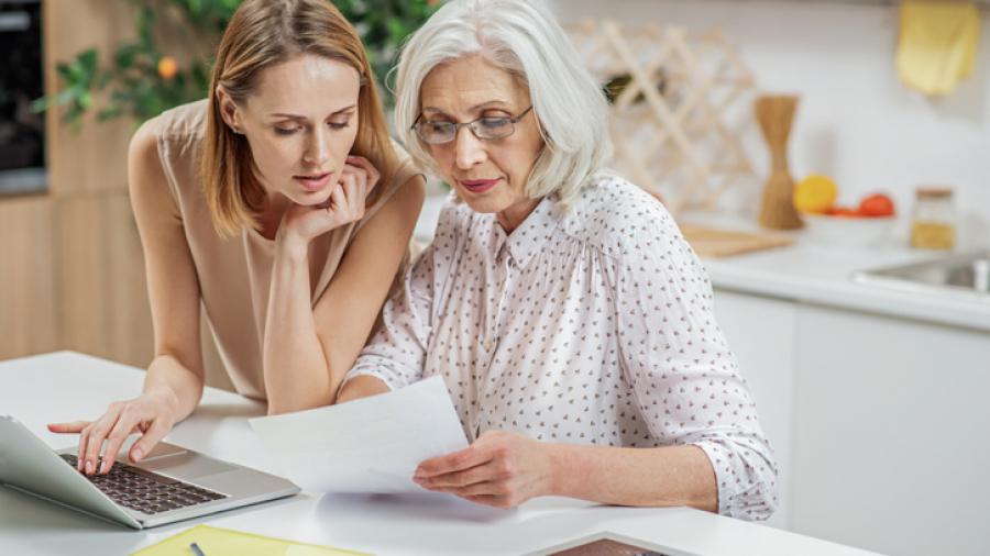Friendly girl explaining some estate planning documentation to parent