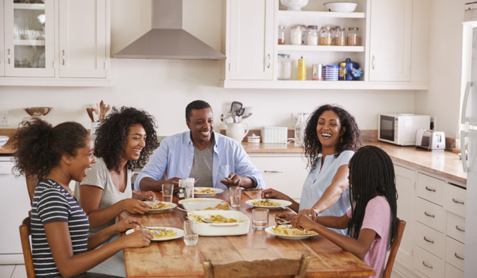 Blended Family With Teenage Children Eating Meal In Kitchen