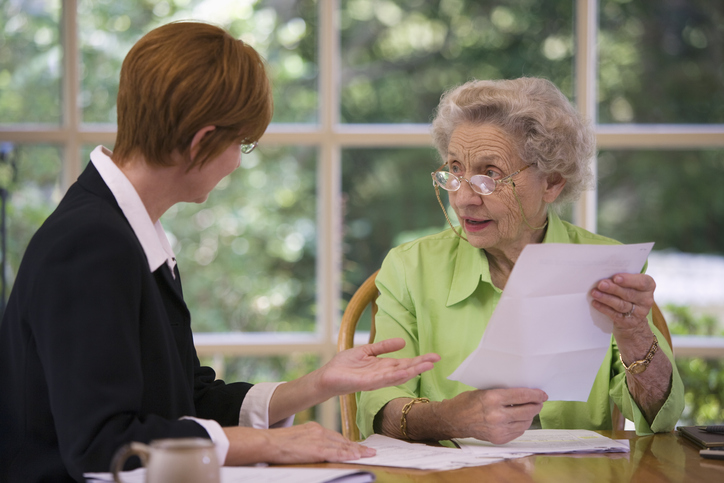 Senior woman meeting with her trustee discussing her estate plan