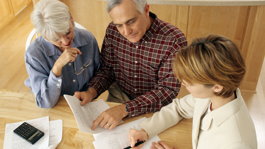 Couple looking over their beneficiary paperwork