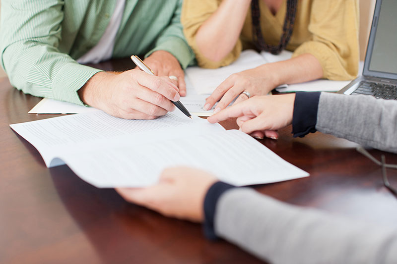 Couple signing business contract