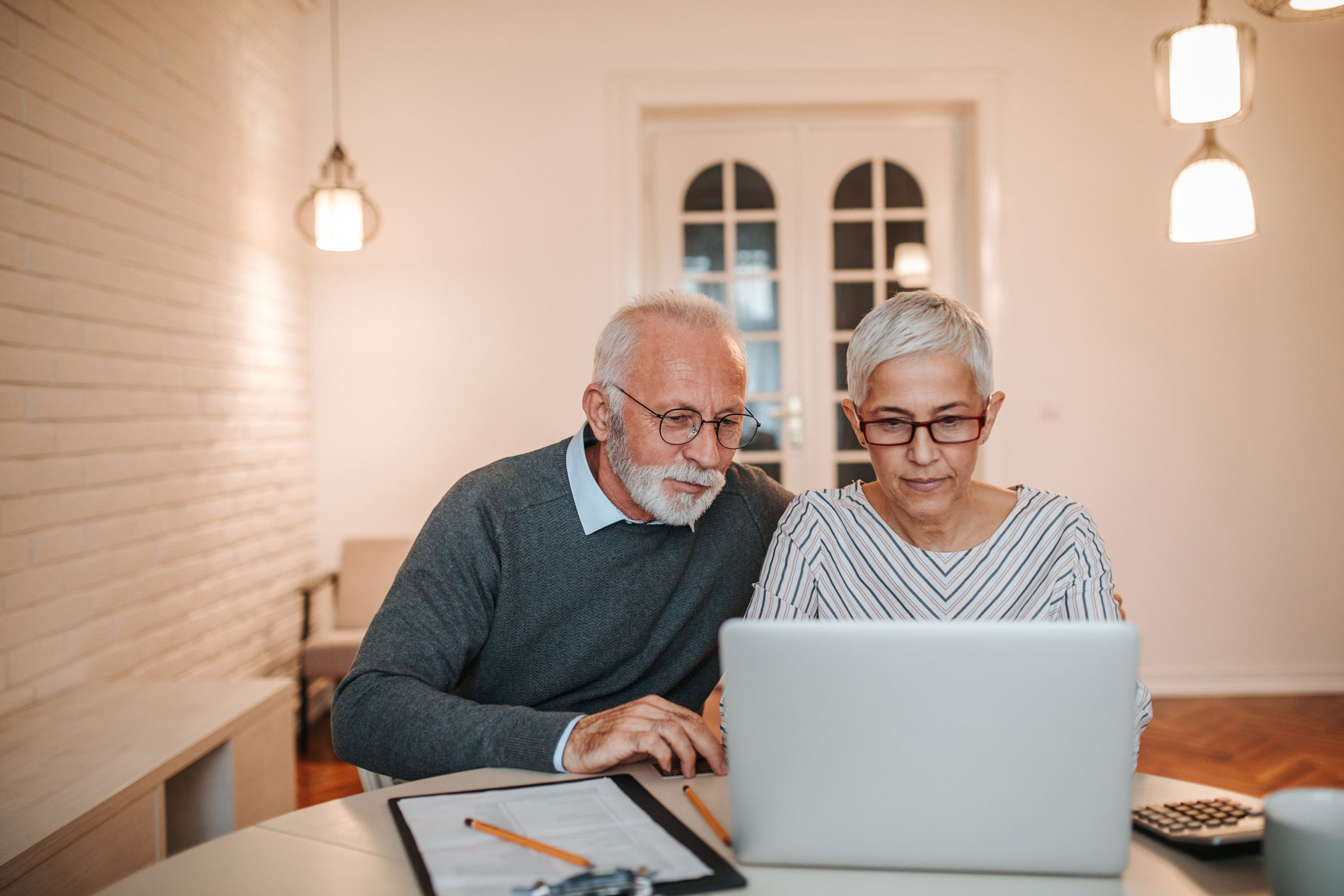Couple attending the Estate Planning Workshop on their laptop